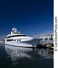 Motorboat - White unmarked luxurious motorboat docked in...