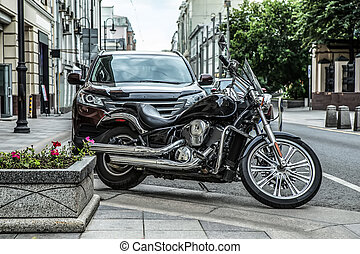 motorcycle and car parked on the street