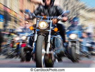 Motorcycle - blurred bike riders rushing at city streeet