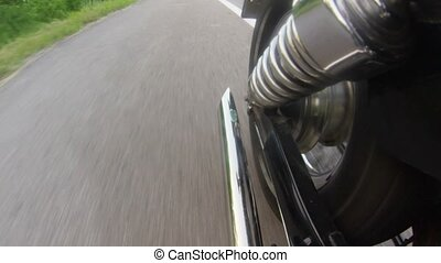 Motorcycle exhaust pipe while driving. Close up - Motorcycle...