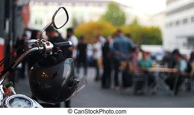 Motorcycle helmet hanging on the handles of the motorcycle...