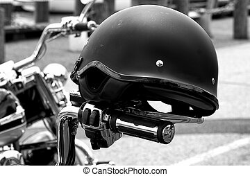 Motorcycle Helmet on Bike - Motorcycle helmet resting on...