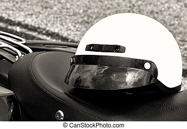 Motorcycle Helmet on Seat - Motorcycle helmet rests on...