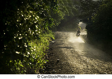 Motorcycle in Costa Rica - Motorcycle on a dirt road at dusk...