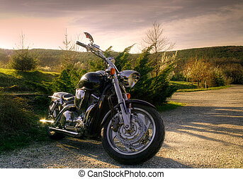 Motorcycle in nature - Black chopper in beautiful rural...
