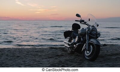 motorcycle on the beach in the evening