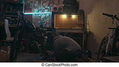 Motorcycle Repair - Man using welding to repair his...