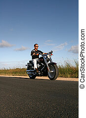 Motorcycle rider 3 - A man cruises on a classic style ...