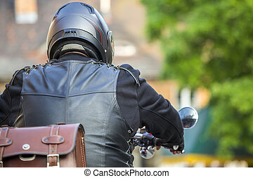 Motorcycle rider in a cute European town
