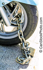 motorcycle secured with padlock