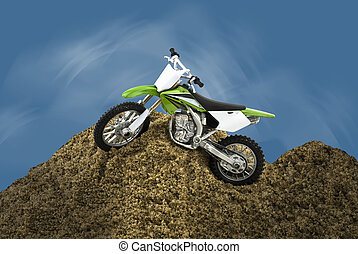 Motorcycle - Single motorcycle toy waiting on a sand hillock...
