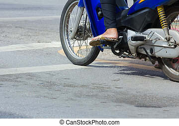 motorcycle stop at white line on junction waiting for...