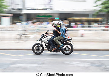 Motorcycle -  Two men on a motorcycle in Valencia, Spain.