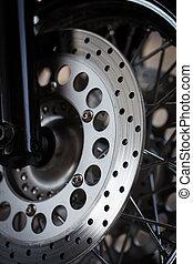 Motorcycle wheel disc brake background in modern scooter bike
