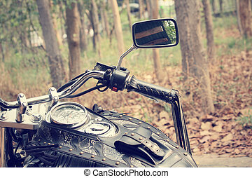Motorcycle with forest