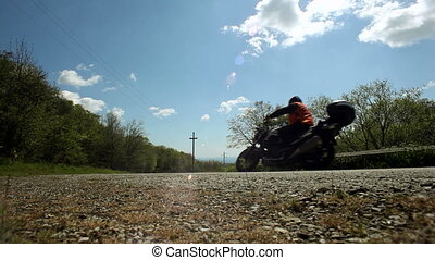 Motorcyclist involved in the race on the track.