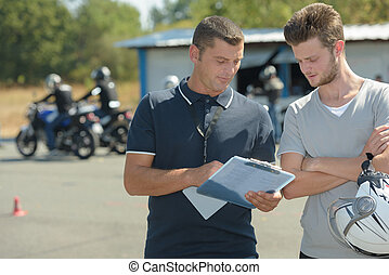 motorcyclist has driving test in moto school for drivers license