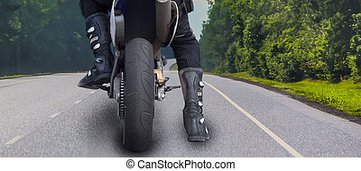 Motorcyclist on a country road.