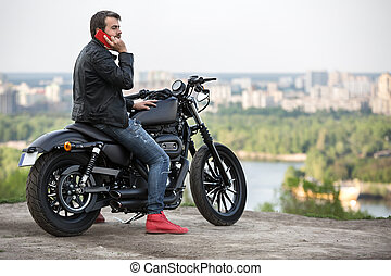 Motorcyclist on the city background