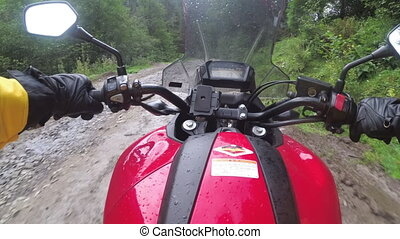 Motorcyclist Rides Off-road in the Rain through Mud and ...