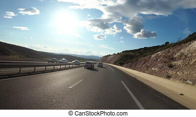 Motorcyclist Rides on a Beautiful Landscape Desert Road in Spain. First-person view