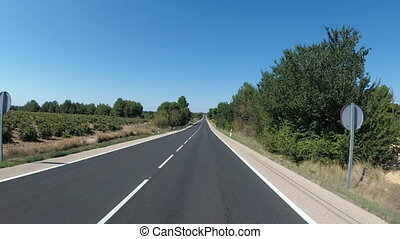 Motorcyclist Rides on a Beautiful Landscape Desert Scenic and Empty Road in Spain. First-person view