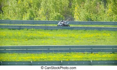 Motorcyclist rides on a curved track, telephoto shot