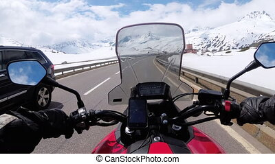 Motorcyclist Rides on Beautiful Landscape Snowy Mountain...
