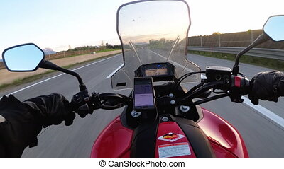 Motorcyclist Rides on the Autobahn at High Speed. View from...