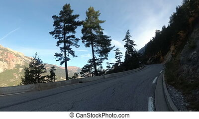 Motorcyclist Rides on the Scenic Mountain Road on Serpentine...
