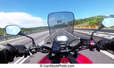 Motorcyclist Riding on Empty Highway. View from behind the Wheel of a Motorbike. POV