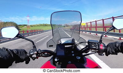 Motorcyclist Riding on Highway. View from behind the wheel of a motorcycle. POV