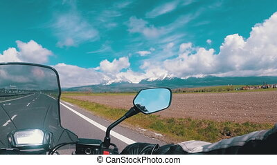 Motorcyclist Riding on Scenic Highway near Tatras Mountain. View from behind the wheel