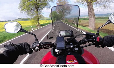 Motorcyclist Riding on the Road near Spiss Castle. Spissky...