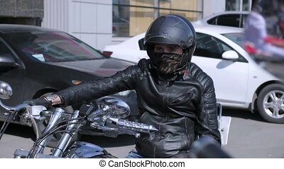 Motorcyclist sittnig on his motorcycle