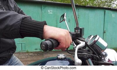 Motorcyclist turns the throttle stick. 4k video