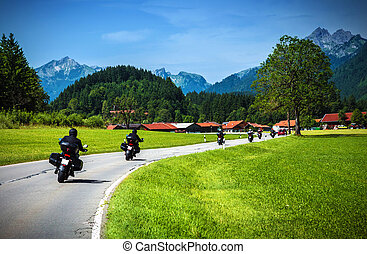 Motorcyclists on mountainous road