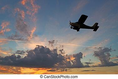 motorflugzeug, silhouette, an, sonnenuntergang