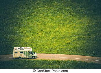Motorhome Camper Van Travel. Class C RV on the Countryside...