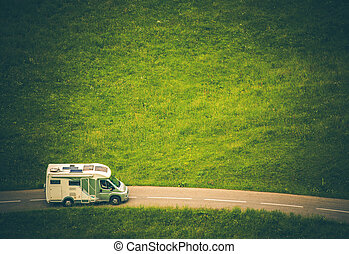 Motorhome Camper Van Travel. Class C RV on the Countryside...