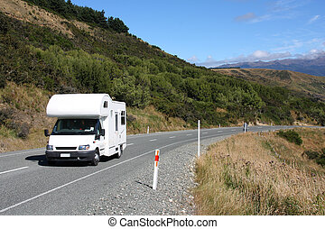 Motorhome in Canterbury region, New Zealand. Recreational vehicle, slightly motion blurred.