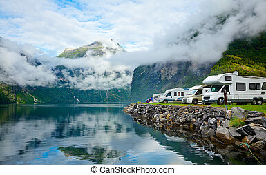 Motorhomes at Norwegian campsite - RV camping by a fjord in...