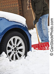 Motorist Digging Car Out Of Snow