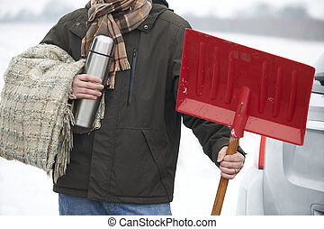Motorist Holding Blanket And Thermos In Case Of Winter Breakdown