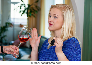 motorist refused alcohol - a young woman with car keys...