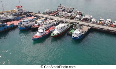 Motorized cutter mooring to moorage in port Fujairah in...