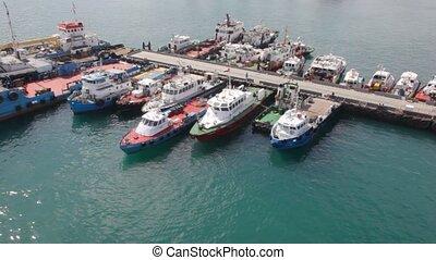 Motorized cutter mooring to moorage in port Fujairah in...