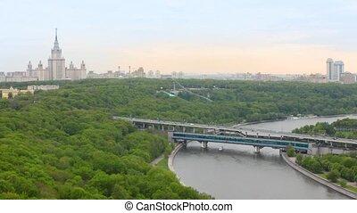 Motorship swim under Luzhnetsky bridge at left stands Moscow...