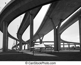 Motorway bridges in all directions in Bangkok, Thailand. Black and white photo.