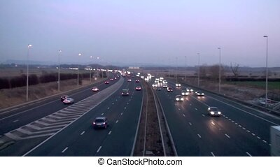 Motorway Dusk - Motorway traffic speeding past in both...